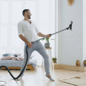 man dancing with vacuum