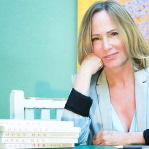 Karen Brody sits with a stack of books